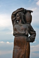 Statue of woman carrying amphora on her shoulder (Horia Varlan) Tags: sky woman statue costume hands traditional amphora hip