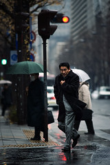 Mate, I know just how you feel! (Alfie | Japanorama) Tags: rain raining rainy man street tokyo japan japanese cold jacket coat red trafficlight signal crossingtheroad walkingintherain streetphotographytokyo streetphotographerstokyo 300mm nikon d700 nikkor300mmf4ed