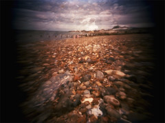 A closer look (kycamlewis) Tags: distortion blur colour beach shadows child doubleexposure shingle pebbles pinhole figures expiredfilm fujireala100 pinholing kycamlewis kylewis pinholblendermini35mm