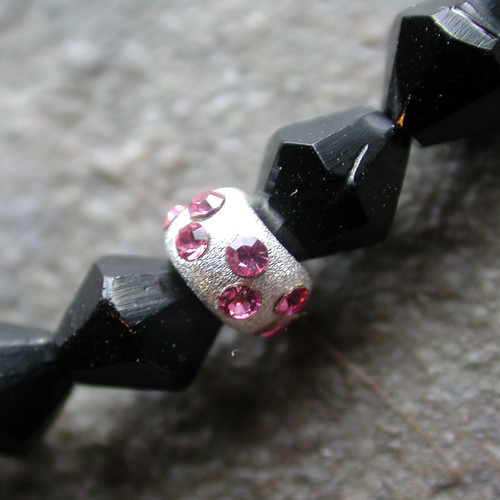 Black glass and silver beads with pink rhinestones
