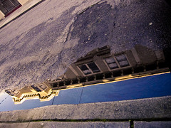 Beneath the Streets (eviloars) Tags: sanfrancisco street water buildings puddle victorian mission gutter 16th curb hoff
