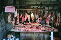 An entire pig, exploded (deepstoat) Tags: street film zeiss 35mm pig blood taiwan yashicat5 giblets guts butchery offal kodakportra deepstoat