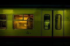 The Green Train and the Orange Traveller (Gilderic Photography) Tags: door light shadow brussels people orange cinema man motion green window station silhouette metal train dark wagon lumix movement europe raw mood darkness belgium belgique belgie gare steel south bruxelles vert panasonic story lumiere porte cinematic brussel fenetre obscurit zuid lightroom bruxellesmidi sncb mnbs gilderic superaplus aplusphoto dmclx3
