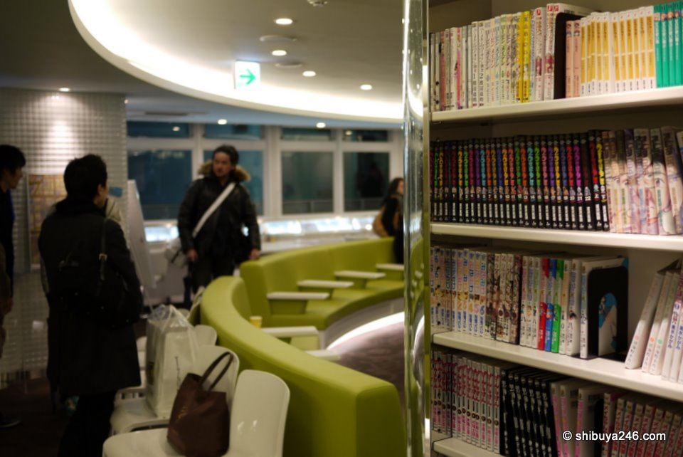 Nice combination of color at the Akiba:F Blood facility. Manga on the shelves with the more hospital style colorful and clean seating around the middle of the room.