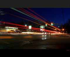 Rush Hour (ReadyAimClick) Tags: street longexposure motion cars canon eos lights evening newjersey nightshot traffic rushhour lighttrails 7eleven stoplights 500d rebelt1i kitlensefs1855mmis
