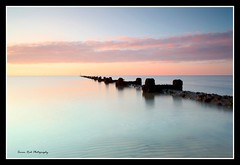 Early morning (Simon Rich Photography) Tags: longexposure morning sea reflection beach clouds sunrise early seaside colours horizon pipe seafront essex clacton martello tendring simonrich mywinners mrmonts simonrichphotography