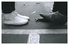 Friend Feet (J. Astra Brinkmann) Tags: blackandwhite bw film feet canon shoes pavement iso400 details megan line canonae1 squish agfa simple brisa wideanglelens agfaapx