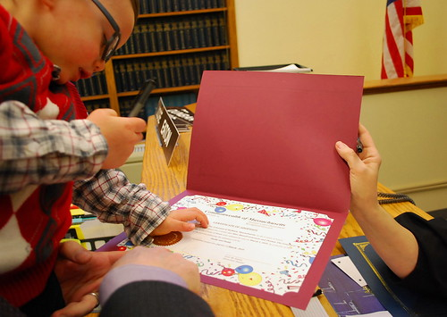 Jonathan signing adoption decree
