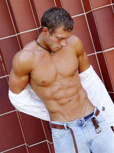 muscular hunk open his shirt shows his muscle body hot man