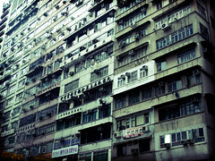 Hong Kong Facade (kevinpoh) Tags: china building window architecture facade hongkong lomo asia apartment outdoor olympus airconditioner kowloon zuiko urbanscenes dwelling 18180mm e620