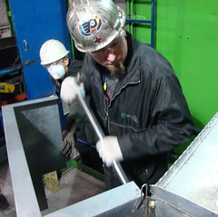Shove It (dmjarvey) Tags: hardhat hat goatee glasses helmet goggles safety gloves overalls zipper worker ladder broom dustmask