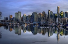 Vancouver Reflections (Brandon Godfrey) Tags: world pictures city sky urban canada reflection water skyline vancouver clouds buildings reflections landscape photography scenery downtown cityscape bc metro photos pics earth britishcolumbia sony towers scene canadian seawall pacificnorthwest northamerica metropolis stanleypark dslr hdr highdynamicrange coalharbour lowermainland a300 photomatix