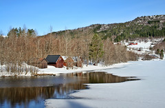 The thaw is only just beginning in some places.... (larigan.) Tags: snow ice reflections farm thaw goldeneye boathouses larigan phamilton engsetdalsvatnet gettyimagesnorwayq1
