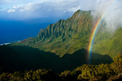 "Rainbow over Kalalau Valley (IronRodArt - Royce Bair (""Star Shooter"")) Tags: ocean park travel blue sea mountain green water beautiful forest landscape island hawaii coast high rainbow colorful view state top horizon scenic peak cliffs na erosion trail valley kauai hawaiian tropical coastline peaks lush overlook pali kalalau majestic puu idyllic vacations breathtaking napali rugged kila steep kokee phea"