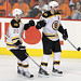 Patrice Bergeron #37 and Daniel Paille #20 of the Boston Bruins celebrates the empty net goal