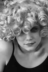 Curly (sabinagreen) Tags: portrait blackandwhite hairy woman white black girl sarah female eyes eyecontact curls curly wig bones curl thin curlyhair collarbone catchlight neckbone