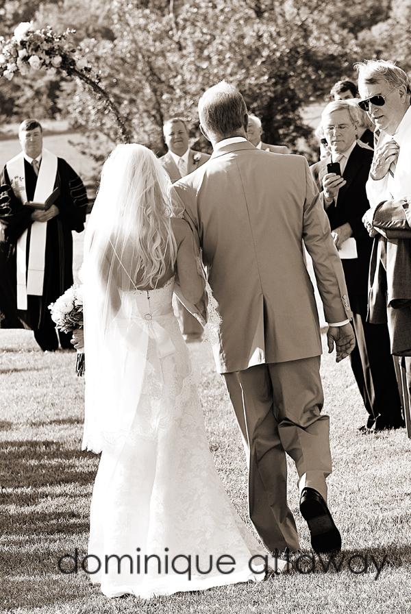 sepia bride walking down the aisle