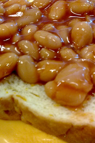 Baked beans and BBQ cheese on corn bread