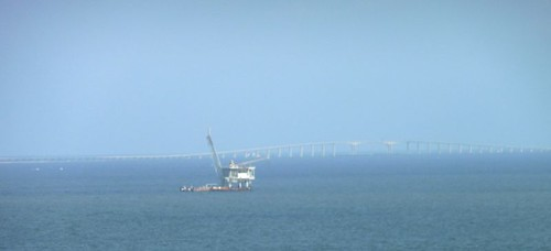 Oil rig and Dauphin Island Bridge