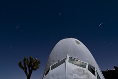 Seven Stone (Lost America) Tags: night airplane nose junk aircraft debris cockpit fullmoon douglas scrap boneyard airliner dc7 aviationwarehouse