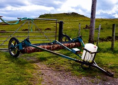 A contraption of unknown purpose. (rustyruth1959) Tags: nikon nikond3200 tamron16300mm scotland highland sutherland strathypoint carpet roller machinery wheels container tube motor bracket liquid unidentifiedcontraption field gate hill farmland rope outdoor post gravel bung tyres