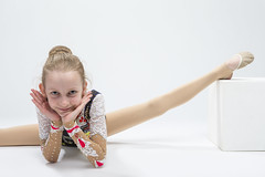 Sport concepts and Ideas. Young Caucasian Female Rhythmic Gymnast Athlete In Professional Competitive Suit Doing Split  Exercise While Posing in Studio Against White (DmitryMorgan) Tags: 1 711years active aerobics art artistic athlete beautiful bend body bodysuit caucasian champion child childhood colorful dynamic elegant exercise female fitness flexible gimnastika girl grace gymnast gymnastics healthy individual lady lifestyle one preschooler professional rhythmic rhythmicgymnastic rhytmic split splits sport sportswear sportswoman sporty stretching studio training wellbeing wellness