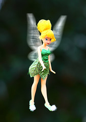 Tinkerbell in Flight (gbrummett) Tags: toy doll dolls bokeh digitalart tinkerbell disney fairy fairies fantasty canonef135mmf2lusmlens photoshopcs3macintosh canoneos5dmarkiicamera grantbrummett