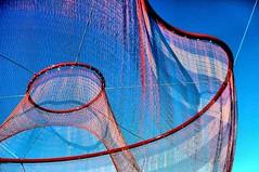 Big net ~ Big fish (losy) Tags: blue red sky fish art net vancouver oval artinstallation netz olympicoval pedigree netwerk filigree winterolympics vancouver2010 filigran artisticphotgraphy losy janetechelman flickrjobdiff rhizomesummum waterskygarden echelmannet losyphotography