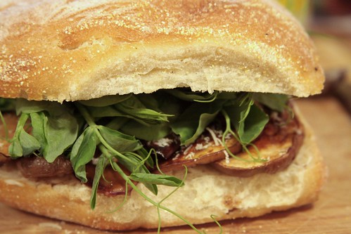 sandwich of aubergine and pea shoots