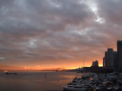Sun Rises on 2010 (ecstaticist) Tags: new eve red cloud canada water vancouver port canon dawn harbor boat cabin day glow cloudy harbour year columbia newyear smokestack british newyears years coal powerboat cruiser daybreak sunsire g10