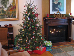 tree (decorated) and fireplace (with candles) on Christmas morning