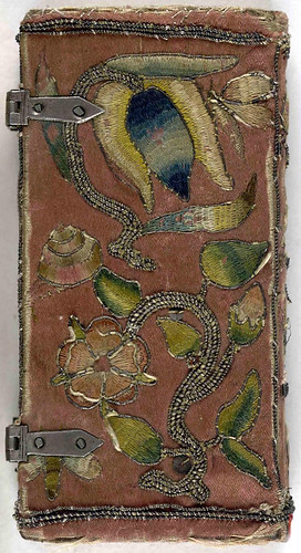 Back cover of 17th century embroidered satin book with two sets of metal clasps.