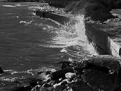 Power of the wave in Black and White (netman007 (Andre` Cutajar)) Tags: sea white black water rocks waves pebbles andre cutajar netman007