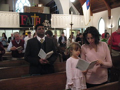 Worshippers sing hymn at 100th anniversary worship service
