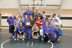 The Burns wrestling team celebrates their district championship. (Photo by TINY PEDERSEN)