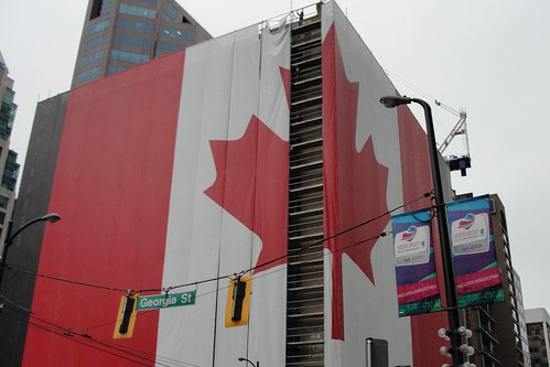 Crews start taking down the giant Canadian flag at Georgia & Howe