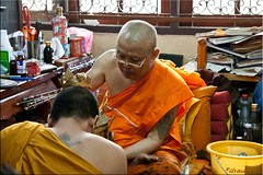 Blessings on the Monks (Ursula in Aus - Away) Tags: tattoo thailand monk yantra tattooing waikhru nakhonpathom   sakyant  tattoofestival  watbangphra nakhonchaisi earthasia nakhonchaisri totallythailand