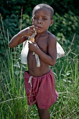 boy from the plantation (flamed) Tags: poverty travel boy portrait rural african country cuba poor latin sack tobacco pinardelrio tobaccofarm