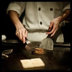 Teppanyaki (terencehonin) Tags: shadow food man cooking japanese 50mm hands nikon dof bokeh 11 depthoffield mf teppanyaki nikkor cinematic manualfocus f12 foiegras d700 fwo5012