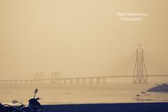 Bandra Worli Sea Link | Mumbai (@k@sh) Tags: sea india canon 350d stand couple candid band sigma enjoy bombay link khan mumbai 1020 shah bandra worli rukh mannat akash