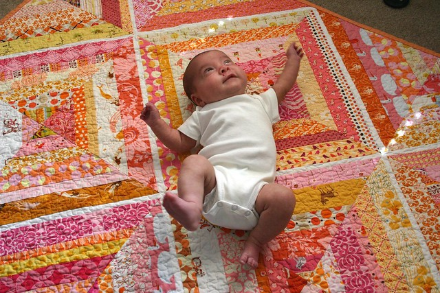 Dreamsicle string quilt, modeled by Violet