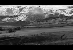 broken fences (sebboh) Tags: ranch bw lake mountains clouds landscape island utah great salt fences antelope plain nikkor105mmf25ais olympuse520