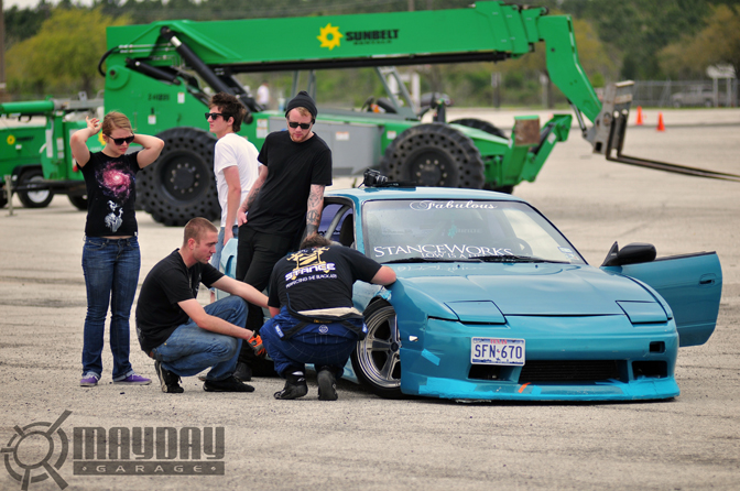 Corey Gilberts StanceWorks sponsored S13 in the pits. DD.