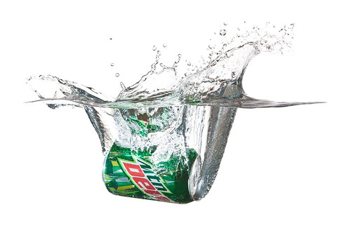 Mountain Dew splashing in water