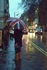 Ⓙ A Rainy Night.. (- M7D . S h R a T y) Tags: uk light cold cars rain night umbrella dark walking lights model walk rainy wordsbyme ®allrightsreserved™ nexttothestreet