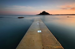 "St.Michael's Mount - I Know it's been done a million times before but I just liked the light around the Mount tonight. Lots of photographers around  the Mount this evening.... I even had wait in turn for the jetty! The photographer in front of me said he was going to 'photoshop out' the painted white squares...they are a part of the jetty so I've left them in!  Tony  Nicer detail if you kindly <a href=""http://bighugelabs.com/onblack.php?id=4538323911&size=large"" rel=""nofollow"">View On Black</a>"