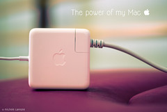The Power of my mac (Explored for Nikon D3000) (Michele Cannone) Tags: apple computer 50mm mac tech badge electricity conceptual charger