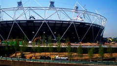 Landscaping begins at the London 2012 Olympic Stadium (Andy Wilkes) Tags: roof building london cup cake danger work landscape site construction crane stadium centre land olympic olympics scape stratford 2012 aquatics londonist