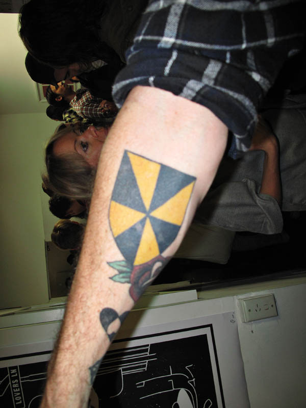 Heraldic shield Tattoo on inside forearm