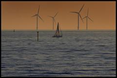 Wind power at sunset, Crosby. (Ianmoran1970) Tags: blue sky orange water windmill club river landscape boat sailing wind sail turbine mersey windturbine ianmoran blundelsands blundelsandssailingclub ianmoran1970